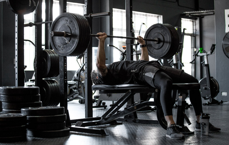 Nutritech athlete performing a bench press
